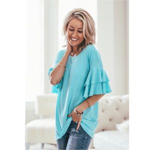 Turquoise blue elbow length ruffle sleeve top NWT